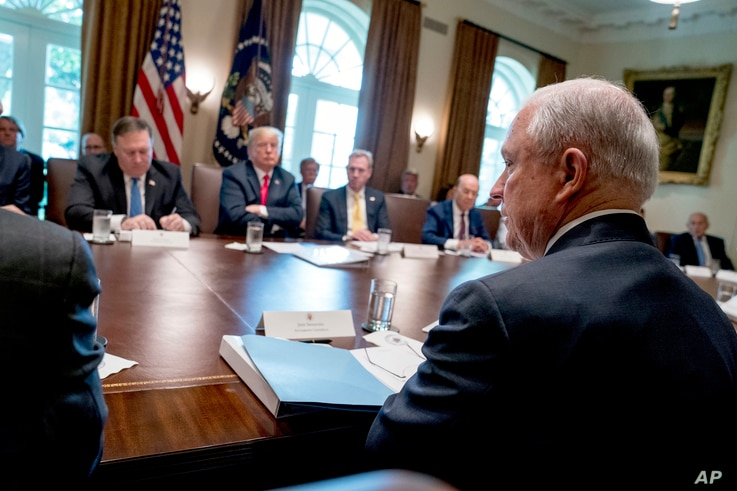 President Donald Trump, second from left, listens as Attorney General Jeff Sessions, right, speaks during a cabinet meeting in the Cabinet Room of the White House, Aug. 16, 2018, in Washington.