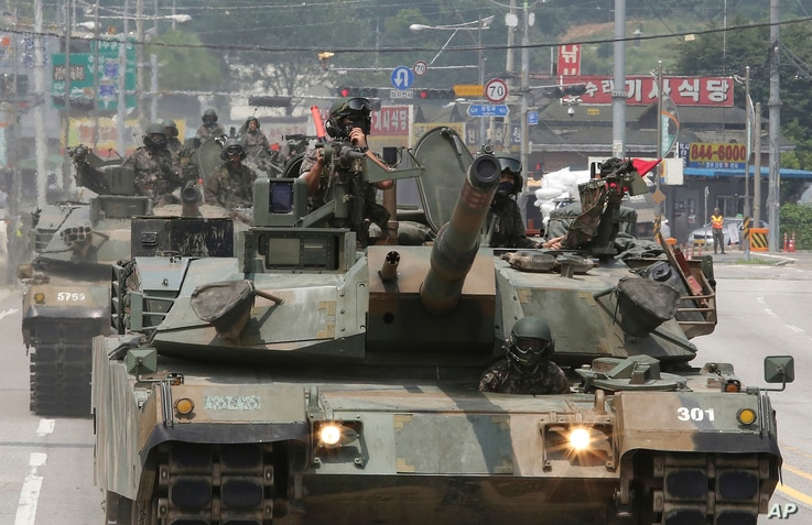South Korean army soldiers ride K-1 tanks during an annual exercise in Paju, South Korea, near the border with North Korea, July 5, 2017.