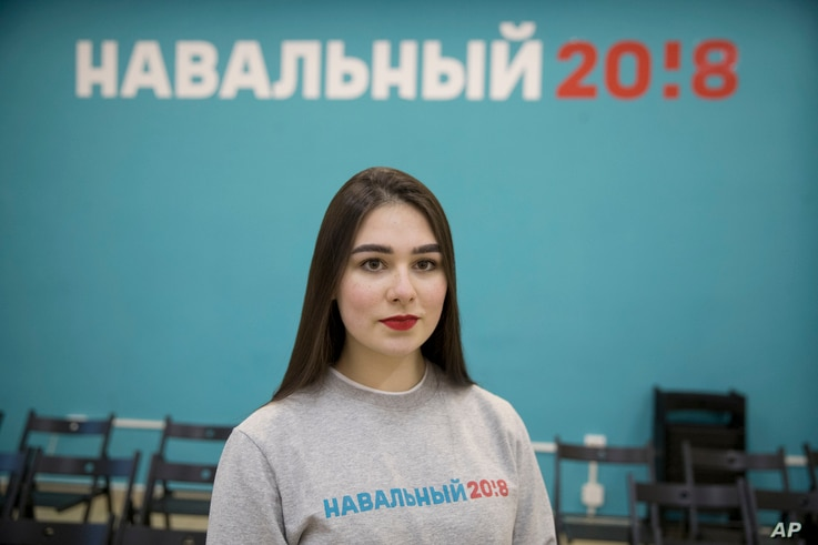 Russian opposition leader Alexei Navalny supporter Ekaterina Osovskaya, 18, poses for a photo in Moscow, Russia, March 2, 2018. Vladimir Putin's legacy depends not only on winning re-election Sunday but also on ensuring that today's first-time voters...