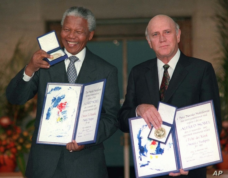 South African Deputy President F.W. de Klerk, right, and South African President Nelson Mandela pose with their Nobel Peace Prize Gold Medal and Diploma, in Oslo, December 10, 1993.