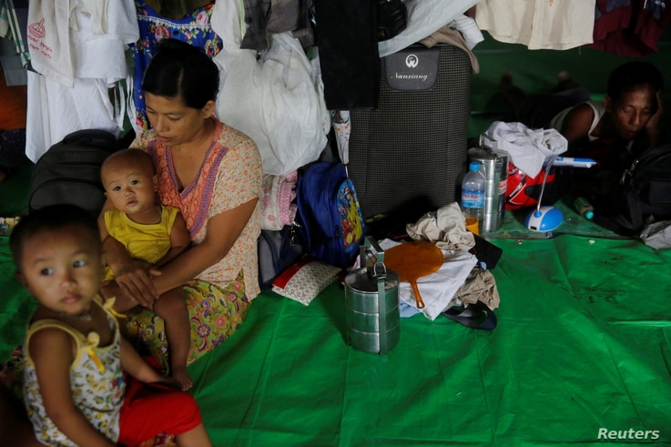 A family who fled violence in a Rakhine state village is seen at a camp for internally displaced persons in Sittwe, Myanmar, Sept. 1, 2017.