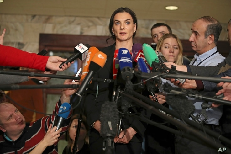 Former Russian pole vaulter Yelena Isinbayeva speaks to the media in Moscow, Russia, Dec. 9, 2016. Isinbayeva says she will oppose blanket bans of Russian athletes after being named the head of the suspended Russian anti-doping agency's new superviso...