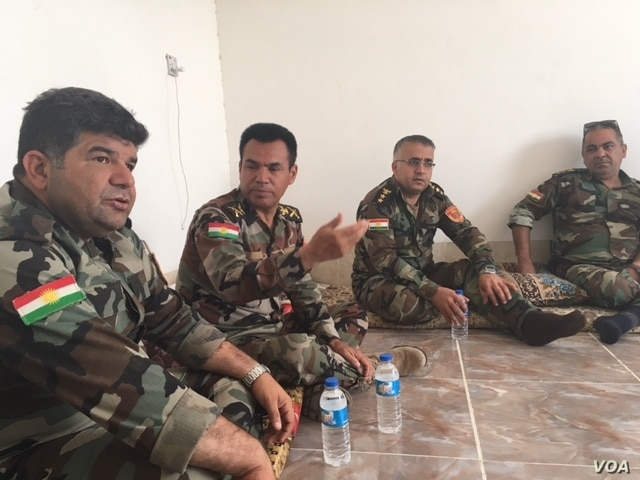 Gen. Salar Taimur (from left), Gen. Saeed Hazhar and other Peshmerga commanders sit inside a house in the newly liberated village of Zarat Khatun, June 6, 2016. (S. Behn/VOA)
