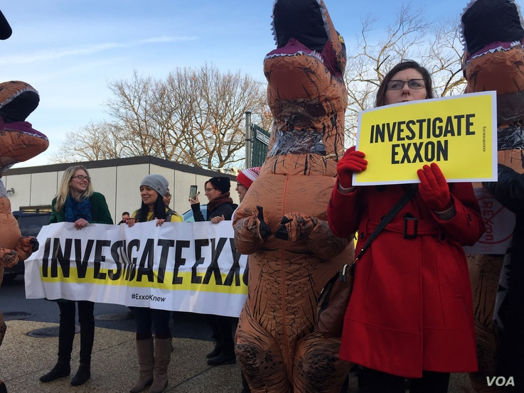 Protesters led by Greenpeace protest the Tillerson confirmation hearing on Capitol Hill, January 11, 2017 (K. Gypson / VOA)