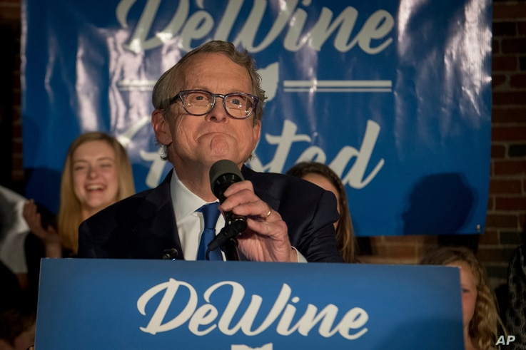 Ohio Attorney General and Republican gubernatorial candidate Mike DeWine addresses supporters after winning the primary election, May 8, 2018, in Columbus.