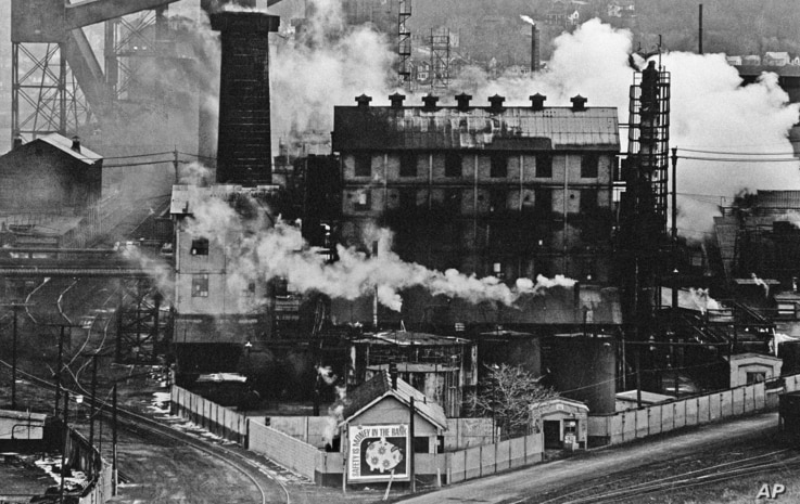 FILE – In this September 1980 file photo, a Jones and Laughlin Steel Corp. coke plant is wreathed in smoke and steam in Struthers, Ohio.