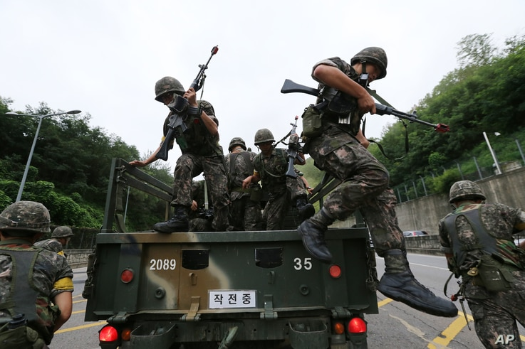 FILE - South Korean army soldiers get off a truck during an anti-terror exercise as part of Ulchi Freedom Guardian in Seoul, South Korea, Aug. 18, 2014.