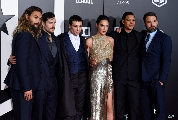 "From left, Jason Momoa, Henry Cavill, Ezra Miller, Gal Gadot, Ray Fisher and Ben Affleck, cast members in ""Justice League,"" pose together at the premiere of the film at the Dolby Theatre, Nov. 13, 2017, in Los Angeles."