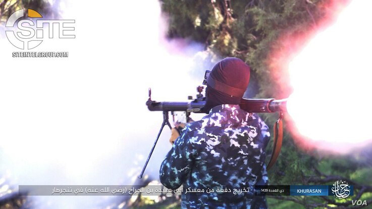 """A fighter fires RPG shells and mortars during the """"Abu Ubaydah bin al-Jarrah"""" training camp in Nangarhar in eastern Afghanistan, as seen in this photo published by the Islamic State's (IS) Khorasan Province, Aug. 6, 2018. (Photo courtesy of SITE Inte..."""