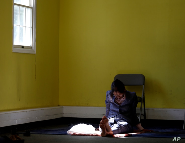 In a photo taken Sept. 23, 2016, a woman prays during a service at the Bernards Township Community Center in in Basking Ridge, New Jersey.