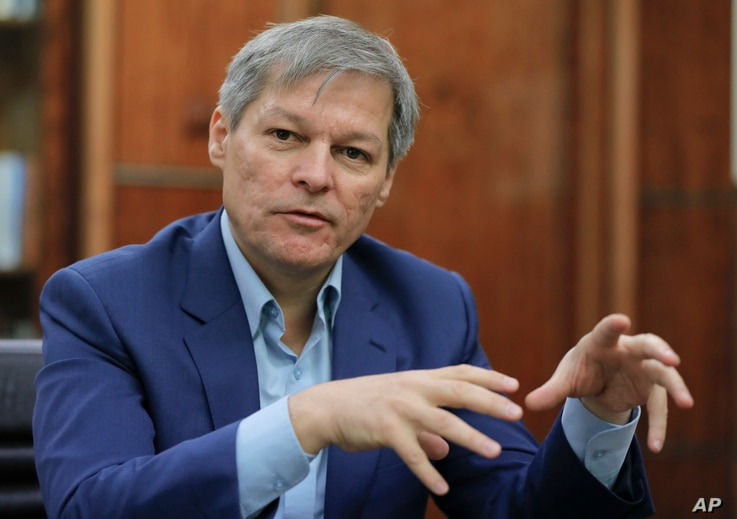 Romanian Premier Dacian Ciolos gestures during an interview with the Associated Press in Bucharest, Romania, Dec. 9, 2016.