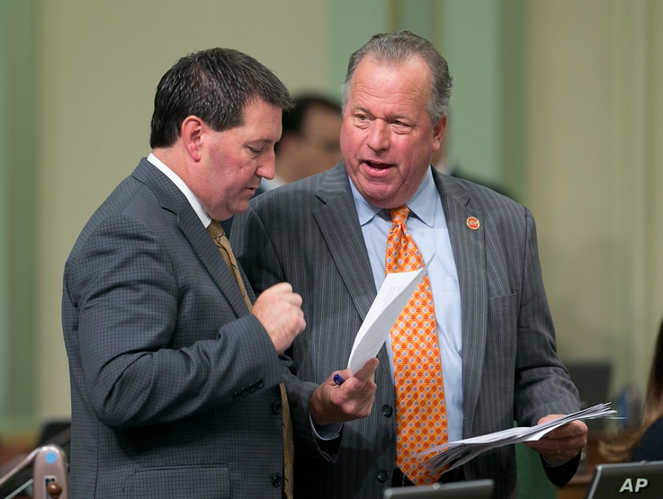 FILE - State Sen. Bill Dodd, D-Napa, right, discusses a measure he has before the Assembly with Assemblyman Tim Grayson, D-Concord, Aug. 31, 2017, in Sacramento, Calif.