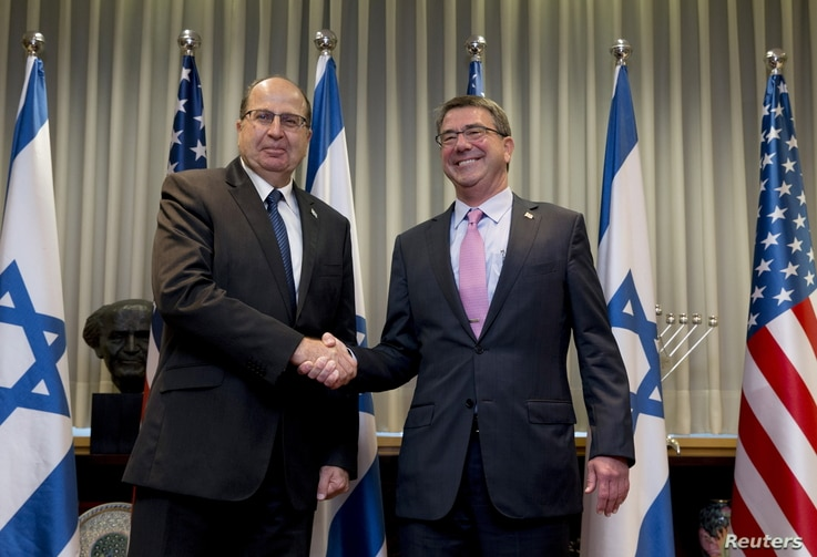 U.S. Secretary of Defense Ash Carter (R) and Israel's Defense Minister Moshe Yaalon shake hands during their meeting at the Kirya base in Tel Aviv, Israel, July 20, 2015.