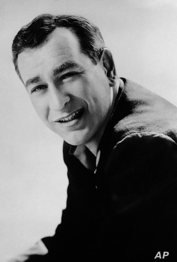FILE - Shelley Berman, pictured in 1961, was a pioneer of a brand of comedy that could evoke laughter from such matters as air travel discomforts and small children who answer the telephone.