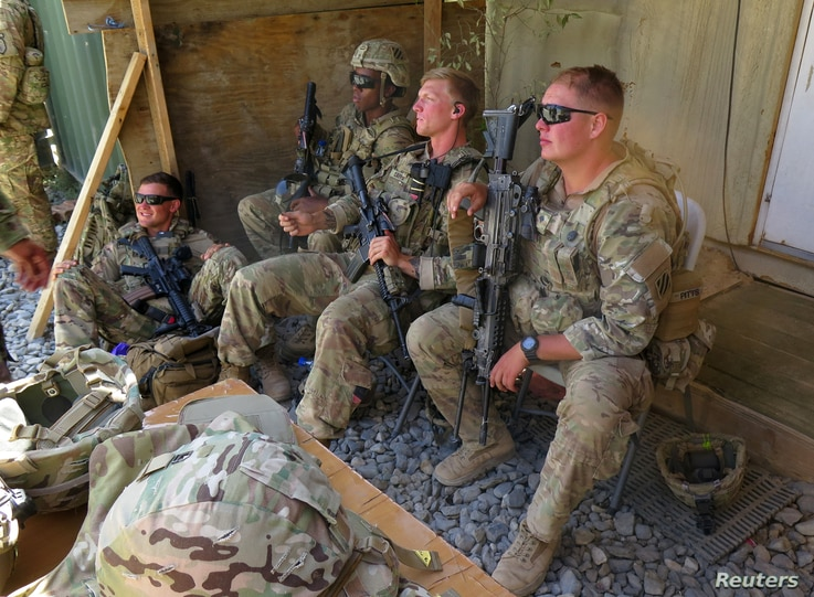 U.S. military advisers from the 1st Security Force Assistance Brigade sit at an Afghan National Army base in Maidan Wardak province, Afghanistan, Aug. 6, 2018.