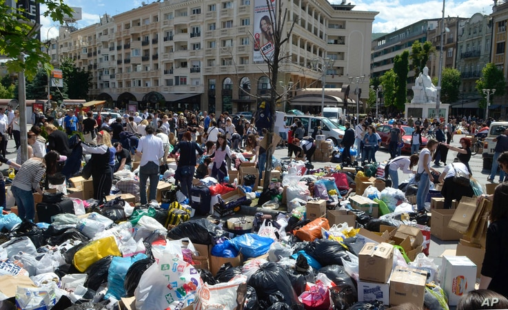 Macedonians collect humanitarian aid of food, hygienic products, clothing and bottled water intended for the flooded regions in Serbia and Bosnia-Herzegovina, in Skopje, Macedonia, May 18, 2014.