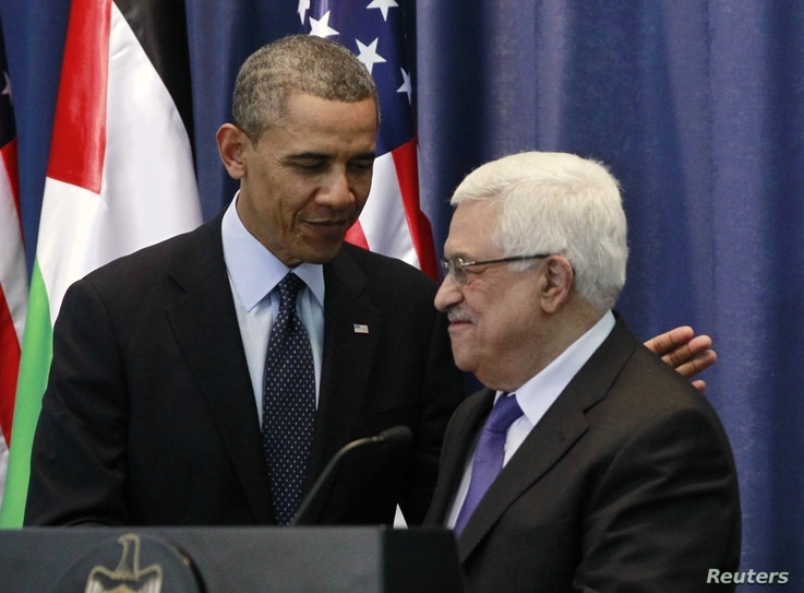 U.S. President Barack Obama participates in a joint news conference with Palestinian President Mahmoud Abbas at the Muqata Presidential Compound in Ramallah, March 21, 2013.