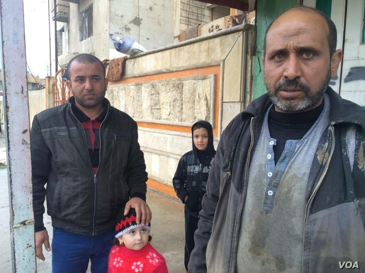 Yunis Mohammad Hassan, a father of three, lives next door to the house in Noor that was attacked.  He and his neighbors say all of their families are experiencing breathing and skin problems on March 4, 2017 in Mosul, Iraq.