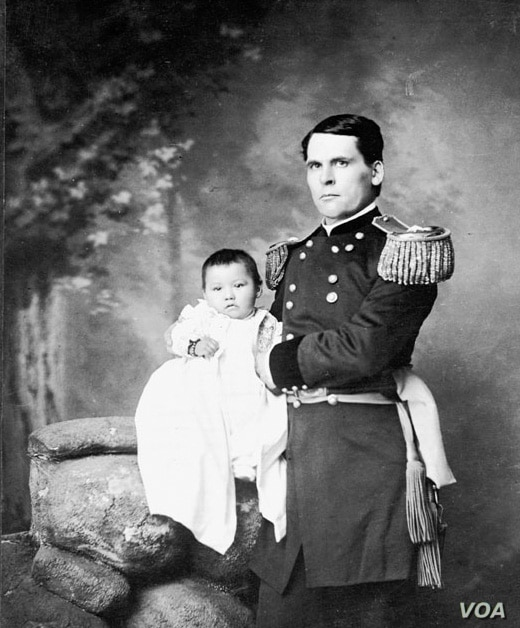 """The original """"Lost Bird,"""" Zitkála Nuni, at age 4 months, held by her adoptive father, U.S. Army General Leonard Colby."""