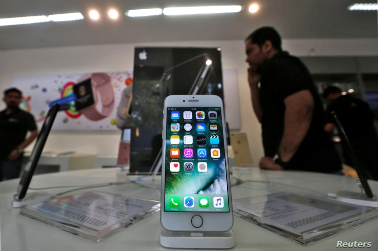 An iPhone is seen on display at a kiosk at an Apple reseller store in Mumbai, India, Jan. 12, 2017.
