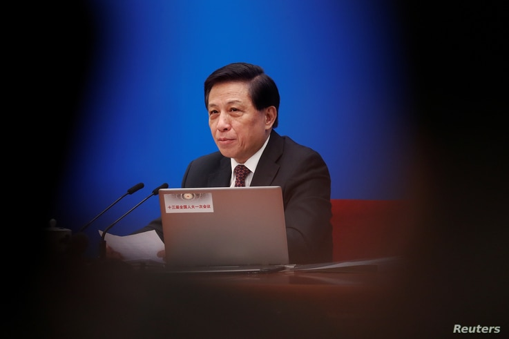 Zhang Yesui, a spokesman for National People's Congress (NPC), addresses reporters ahead of China's annual session of parliament at the Great Hall of the People in Beijing, China, March 4, 2018.