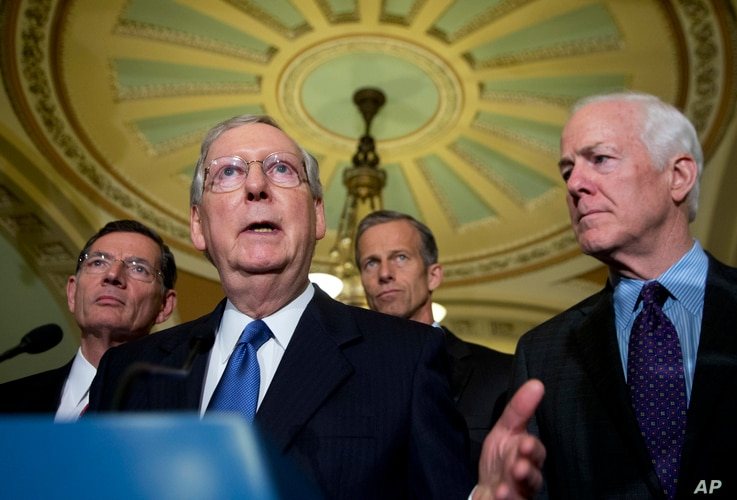 Senate Majority Leader Mitch McConnell of Ky., with, from left, Sens. John Barrasso, R-Wy., John Thune, R-S.D., and Senate Majority Whip John Cornyn, R-Texas, speaks to reporters on Capitol Hill in Washington, May 10, 2016.