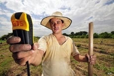 A hand-held satellite device helps a seed collector in Columbia pinpoint wild relatives of stable plants.