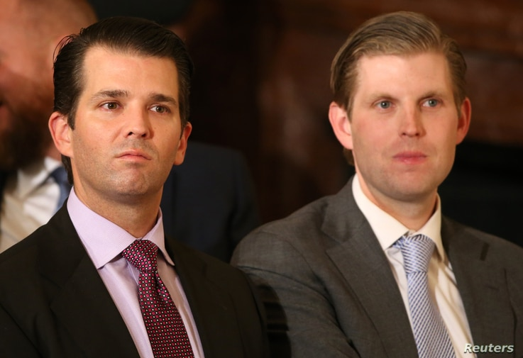 U.S. President Donald Trump's sons Donald Trump Jr. (L) and Eric Trump sit in the audience waiting to watch their father announce his nominee for the  empty associate justice seat at the U.S. Supreme Court, at the White House in Washington, D.C., U.S...