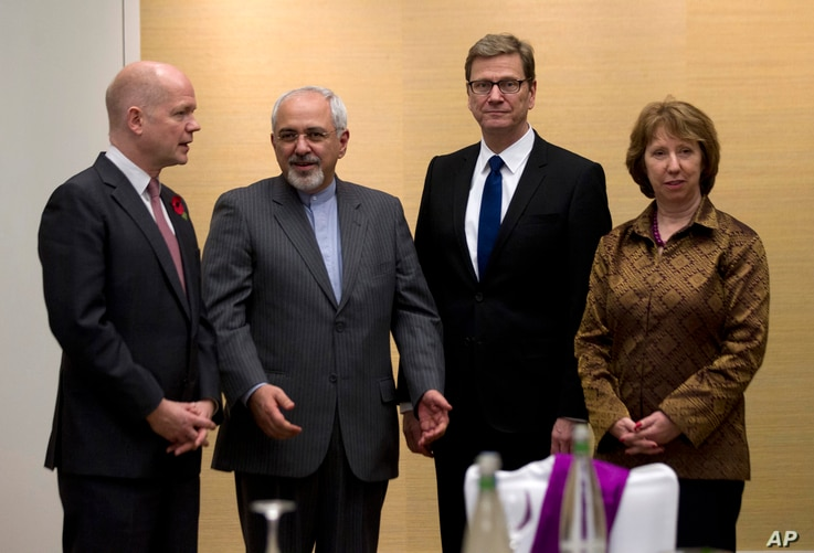 British Foreign Secretary William Hague, left, Iranian Foreign Minister Mohammad Javad Zarif, second left, Germany's Foreign Minister Guido Westerwelle, and EU High Representative for Foreign Affairs, Catherine Ashton, right, gather for the third day...