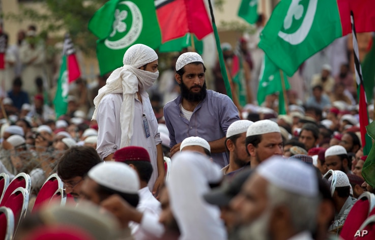 FILE - Supporters of banned sectarian group Sipah-e-Sahaba listen to their leaders at a gathering in Islamabad, Pakistan, Oct. 4, 2013. Pakistan's DAWN newspaper says that 41 of the 64 extremist organizations banned by the government operate freely o...