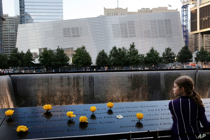 FILE -  A girl is seen at the National September 11 Memorial and Museum in New York City, Sept. 8, 2013.