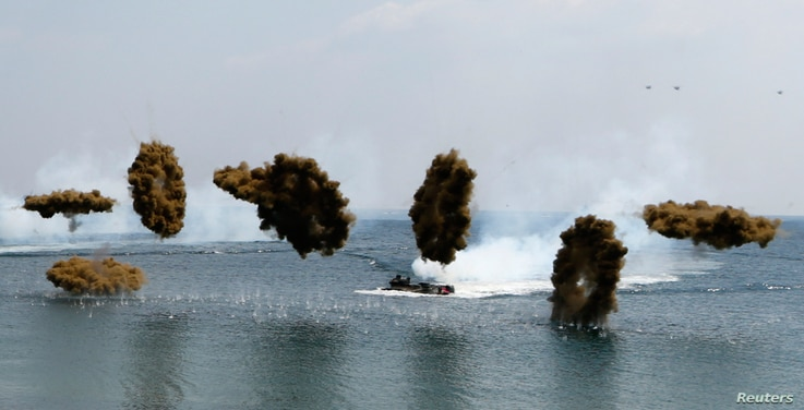 Amphibious assault vehicles of the South Korean Marine Corps throw smoke bombs during a U.S.-South Korea joint landing operation drill in Pohang, southeast of Seoul, April 26, 2013. The drill is part of the two countries' annual military training cal...