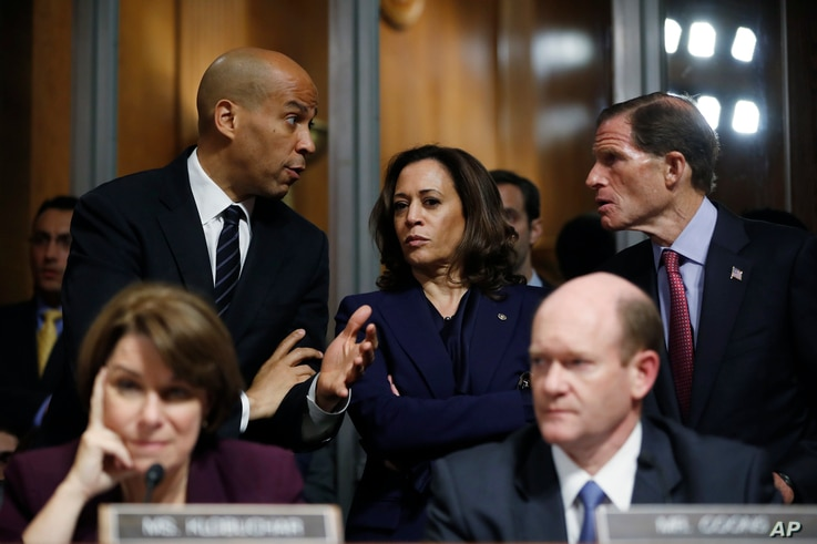 FILE - Senate Judiciary Committee members Sen. Cory Booker, D.-N.J., top left, Sen. Kamala Harris, D-Calif., and Sen Richard Blumenthal, D-Conn., right, talk as Sen. Jeff Flake, R-Ariz., discusses his concerns before the committee on Capitol Hill in ...