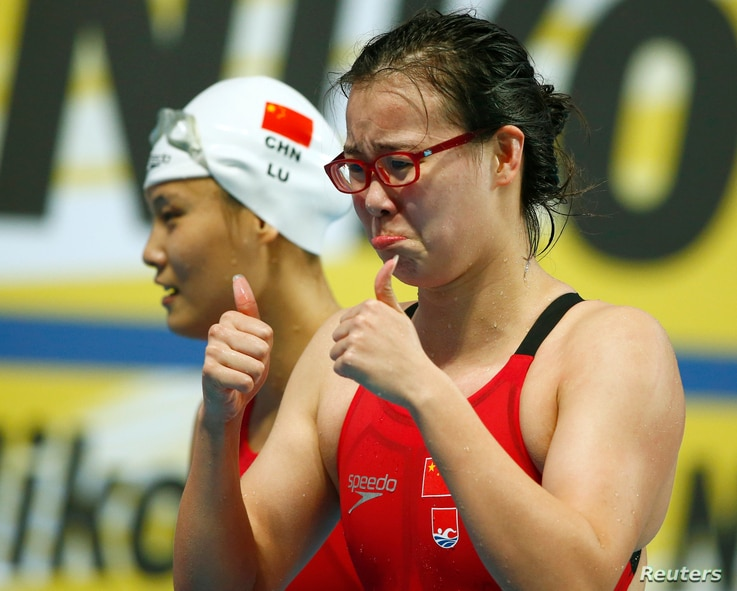 China's Fu Yuanhui and Lu Ying (L) react after winning the women's 4x100m medley relay final at the Aquatics World Championships in Kazan, Russia, August 9, 2015.
