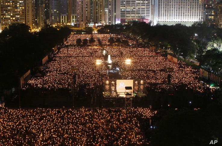 Tens of thousands of people attend a candlelight vigil at Hong Kong's Victoria Park Monday, June 4, 2012 to mark the 23rd anniversary of the Chinese military crackdown on the pro-democracy movement in Beijing.