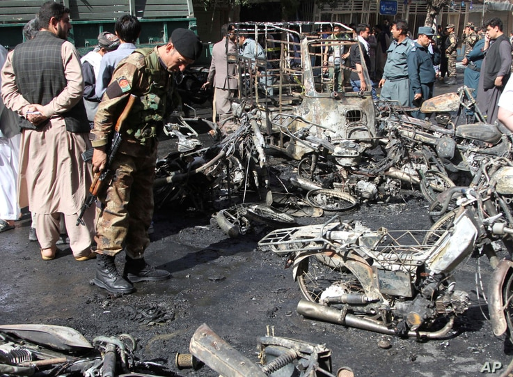 Afghan security forces inspect the site of a blast in Herat, Afghanistan, June 6, 2017.