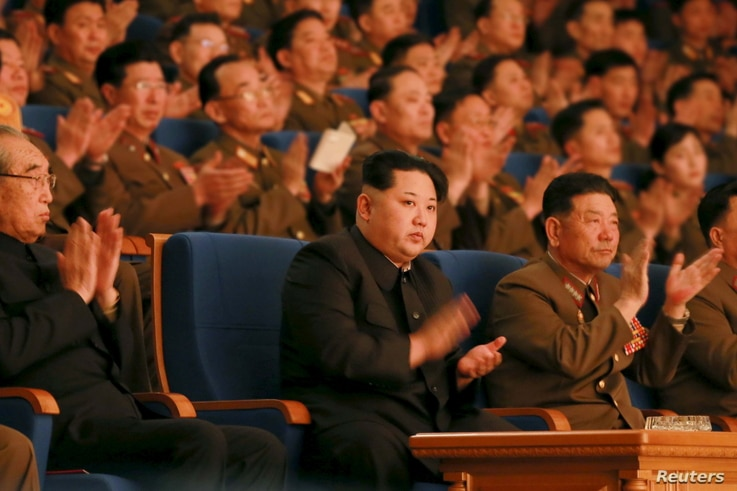 North Korean leader Kim Jong Un (C) applauds during a concert marking the 70th founding anniversary of the Korean People's Army (KPA) military band in this undated photo released by North Korea's Korean Central News Agency (KCNA) in Pyongyang, Feb. 2...