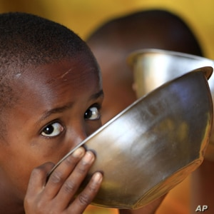 Somali refugee boys eat porridge during break time at the Liban integrated academy at the Ifo refugee camp in Dadaab.