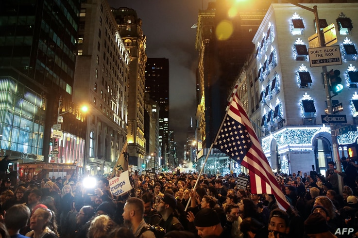 Protesters flood Fifth Avenue as they rally against Donald Trump outside Trump Tower in New York City, Nov. 9, 2016.