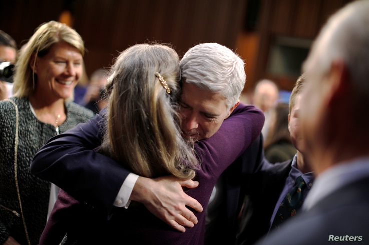 Supreme Court nominee Neil Gorsuch hugs family members during a break in his confirmation hearings before the Senate Judiciary Committee in Washington, March 22, 2017.