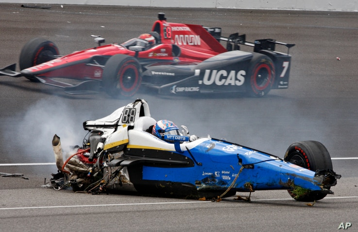 Scott Dixon, of New Zealand, sits in the remains of his car after going airborne in a crash during the running of the Indianapolis 500 auto race at Indianapolis Motor Speedway, May 28, 2017, in Indianapolis, Indiana.