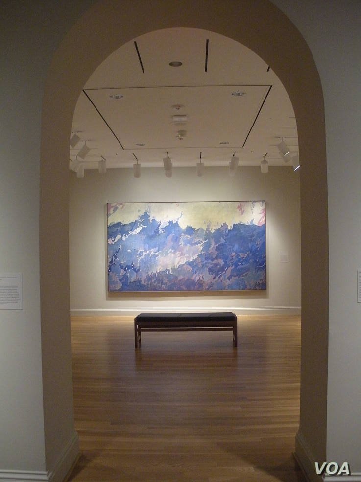 """The painting """"Aspiration"""" by Augustus Vincent Tack is seen at The Phillips Collection, in Washington, D.C., March 2014. (J. Taboh/VOA)"""