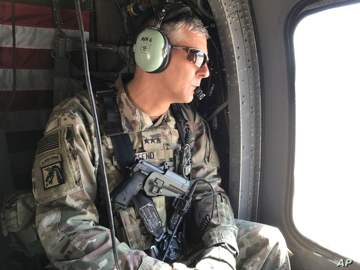 FILE - U.S. Army Lt. Gen. Stephen Townsend surveys positions during a tour north of Baghdad, Iraq, Feb. 8, 2017.