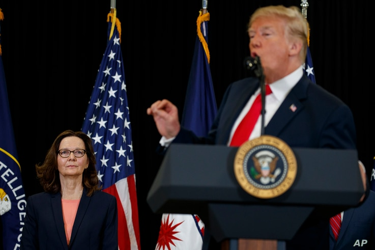 Incoming Central Intelligence Agency director Gina Haspel listens as President Donald Trump speaks during a swearing-in ceremony at CIA Headquarters, May 21, 2018, in Langley, Virginia.