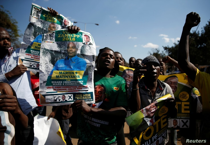 Supporters of the ruling ZANU-PF party of President Emmerson Mnangagwa celebrate following general elections in Harare, Zimbabwe, July 31, 2018.