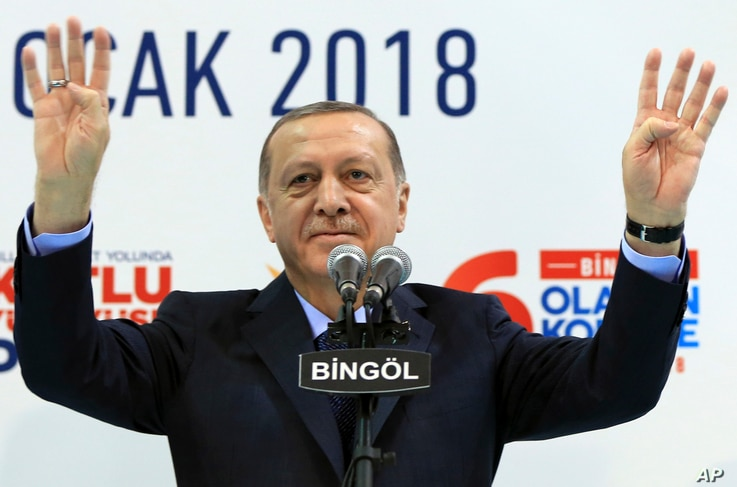 Turkey's President Recep Tayyip Erdogan gestures to supporters of his ruling Justice and Development Party at a rally in Bingol, Turkey, Jan. 13, 2018. Erdogan has said Turkey will oust Kurdish militants from Afrin, northern Syria, as the military sh...
