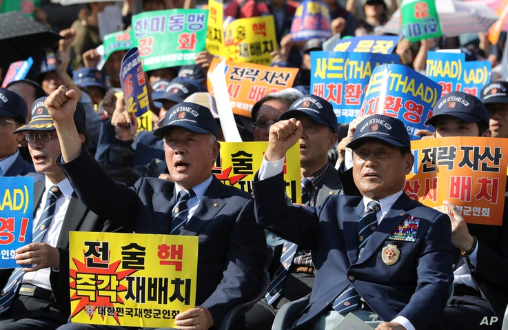 Members of the Korean Veterans Association shout slogans during a rally denouncing North Korea's nuclear and missile provocation in Seoul, South Korea, Sept. 12, 2017.