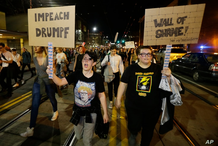 Protesters call for the impeachment of President-elect Donald Trump as they march in Seattle, Nov. 9, 2016.