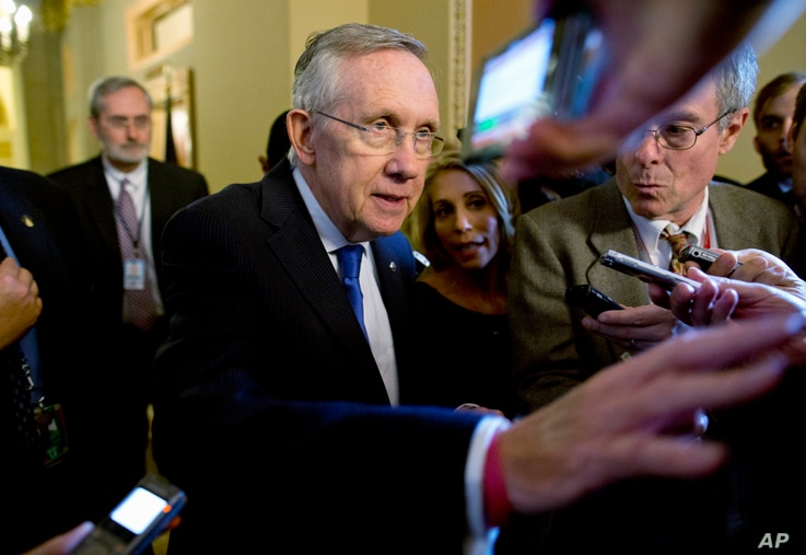 Senate Majority Leader Sen. Harry Reid is surrounded by reporters after leaving the office of Senate Minority Leader Sen. Mitch McConnell on Capitol Hill, Oct. 14, 2013.