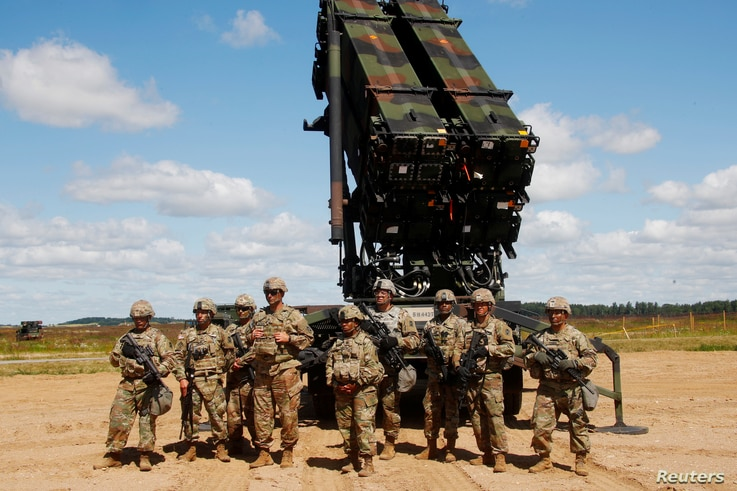 U.S. soldiers stand next to the Patriot, a long-range air defense system, during an air defense exercise near Siauliai, Lithuania, July 20, 2017.